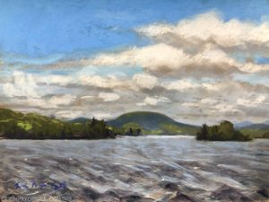 Pastel landscape painting of an Adirondack lake, with choppy waves, white clouds in the blue sky, and highlights of sun on the trees and mountains on the far shore.