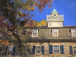 Pastel painting of the stonework, slate roof and copper cupola of the historic Moravian Bell House in Bethlehem, PA, with an autumn tree and deep blue sky.